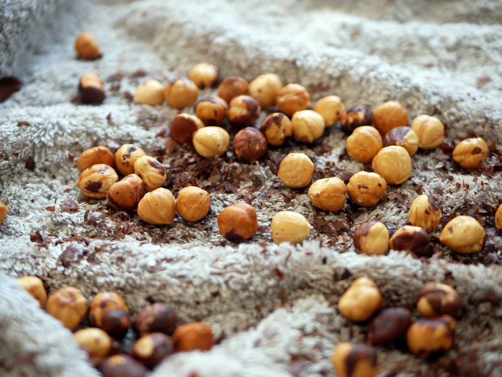 Peeling hazelnuts