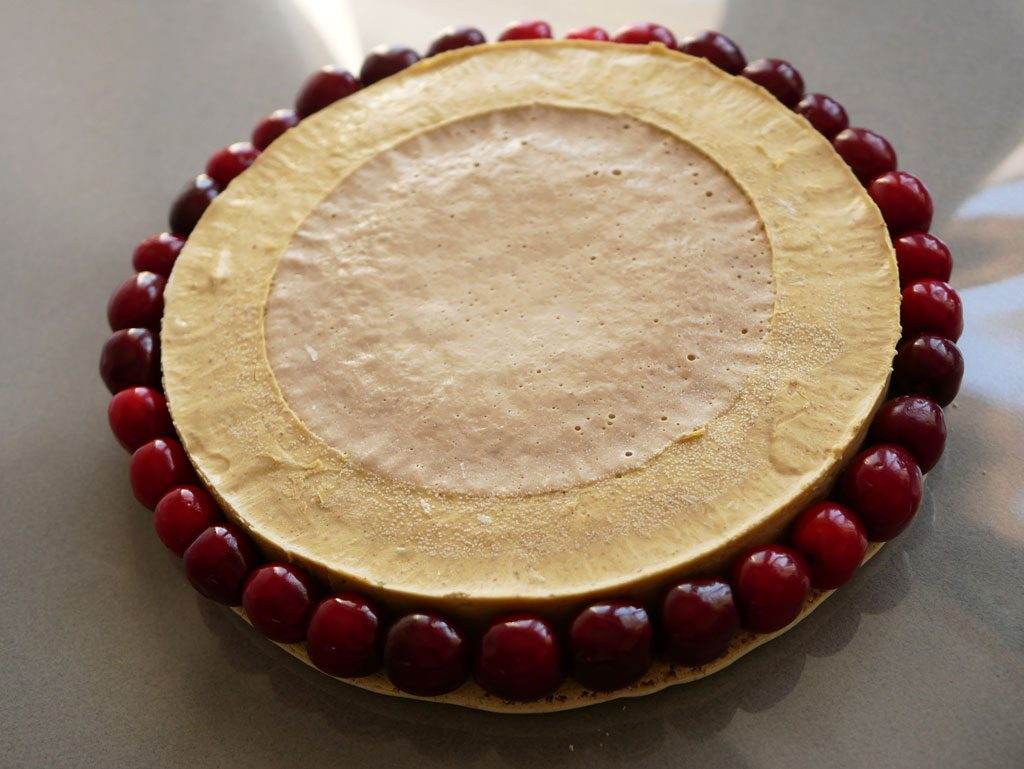 Pistachio and cherries macaron cake