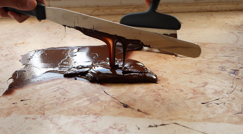 Tempering chocolate on marble