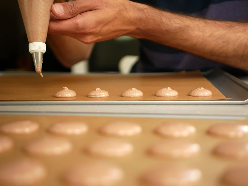 Piping macarons