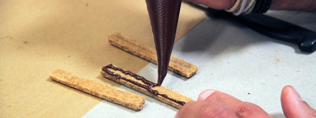 Gluing Gingerbread pieces with chocolate
