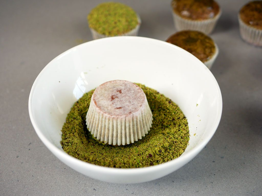 Decorating the muffins with ground pistachio