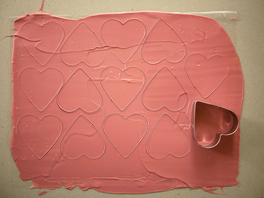 Cutting out ruby chocolate hearts