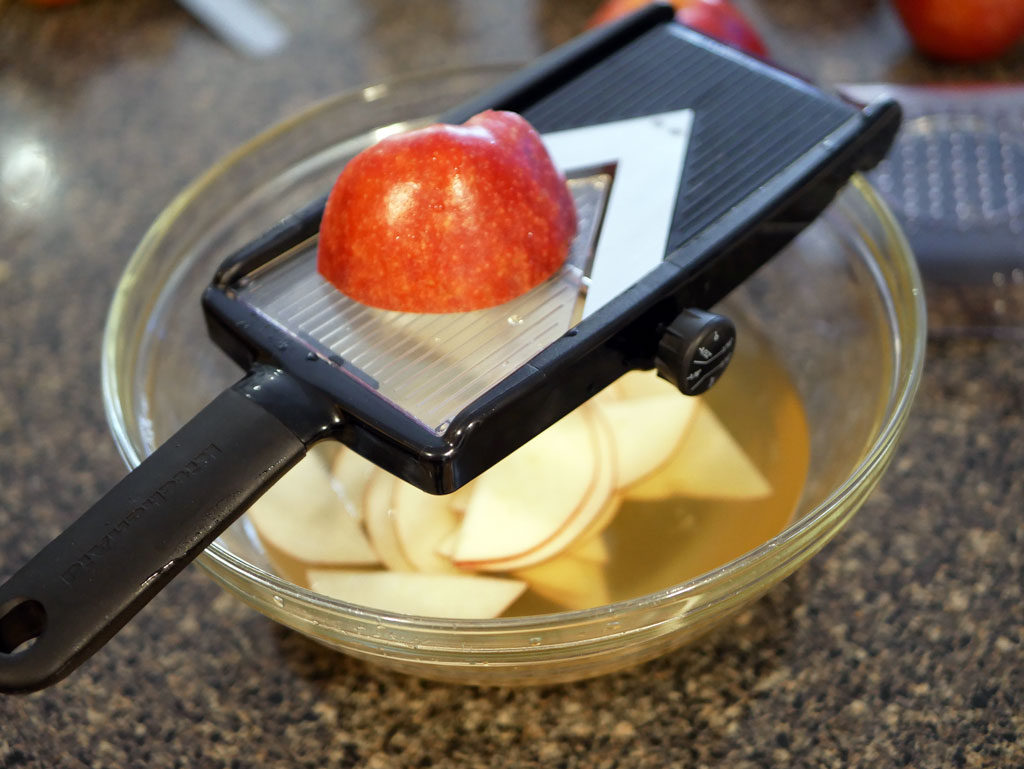 Slicing the apples with a mandoline